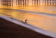 Swimming in colour (Alex Bamford) Tags: winter colour swim sunrise pier saturated brighton freezing explore lomokev palacepier ln interestingness3 explored i500 flickrsbest fineartphotos alexbamford flickr:user=lomokev flickr:nsid=40962351n00 thebigbambooly brightonbuccaneer wwwalexbamfordcom