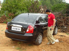 Amit Tandon checking out his pet (aanjhan) Tags: trekking bangalore rappelling rbin ramnagar chimneyclimbing