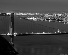 San Francisco At Night (kudaker) Tags: sanfrancisco longexposure bridge blackandwhite skyline nightshot monotone pb moo goldengatebridge goldengate citylights aviles pf e500 flickrsbest