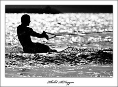 On the surface (Khalid AlHaqqan) Tags: sea bw white black ski reflection silhouette canon surface khalid 100400mm artisticexpression 40d abigfave alhaqqan diamondclassphotographer betterthangood theperfectphotographer goldstaraward