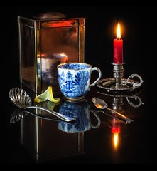 The Art of Tea (memoryweaver) Tags: flame candlelight candle candlestick chamberstick spoon caddy brass copper black reflection memoryweaver pattern willow antique blueandwhite cup teacup tea still life stilllife