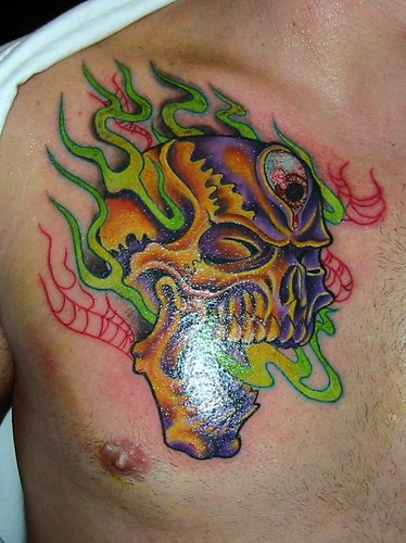 Skull tribal full colored chest tattoo