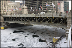 Frozen Michigan Ave. Bridge (mmayes) Tags: bridge winter snow chicago building ice river frozen crossing windy michiganave flags pedestrians tribune 30mmsigma