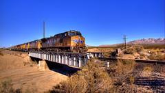 Desert Chase (Thad Roan - Bridgepix) Tags: railroad bridge train landscape sand track desert steel engine bridges rail railway brush wash unionpacific locomotive traintrack kelso cima bridging mojavenationalpreserve nipton 200612 bridgepixing bridgepix