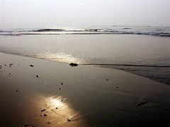 Sun on the Sand (GlimpseOfLight) Tags: sea sun india reflection beach sand vizag andhrapradesh rkbeach visakhapattanam