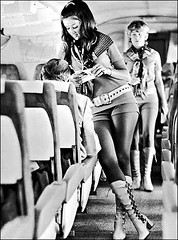 Yes, these are flight attendants, they used to call them stewardesses