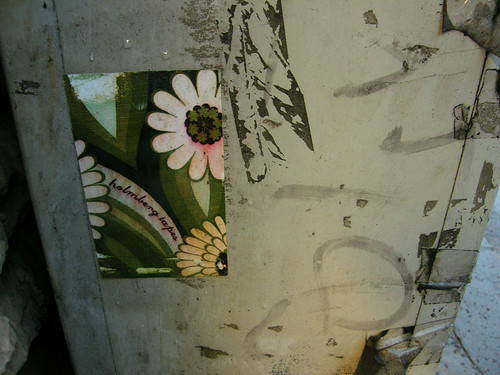 sticker of flowers on a concrete beam