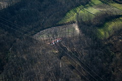 Power line near Malnate (_ Night Flier _) Tags: above travel sky italy panorama tree green nature forest airplane landscape flying high view earth top aviation aerial fromabove electricity powerline lombardia varese cessna skyview voltage lombardy birdeye aeronautic malnate
