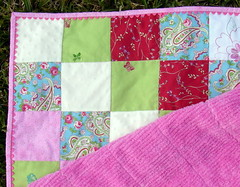 corner of girly patchwork quilt with rick rack