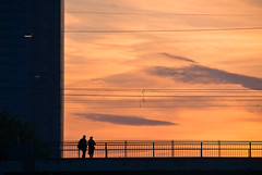 People on a bridge at sunset (manganite) Tags: bridge light sunset sky people orange topf25 colors lines clouds digital buildings germany dark geotagged dawn evening interestingness nikon colorful europe bonn power tl silhouettes explore wires onecolor d200 nikkor dslr rheinaue posttower themoulinrouge northrhinewestphalia i500 interestingness383 18200mmf3556 utatafeature manganite nikonstunninggallery konradadenauerbrcke thecolororange geo:lat=50711678 date:year=2008 geo:lon=7146177 date:month=may date:day=3 format:ratio=32 stadtgetty2010