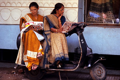 NEWSPAPER ON A SCOOTER (BoazImages) Tags: life street india topv111 photography newspaper women asia scooter daily tradition hindu sari gujarat boazimages lpcandid