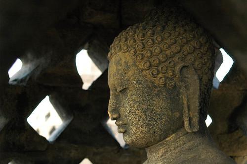 Buddha inside a stupa at Borobudur Temple Complex