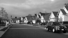 American Street (Lanterna) Tags: street houses sky bw usa sunlight monochrome car architecture shadows patterns nj american repetition suburbs grayscale plannedcommunity retirementcommunity middleamerica