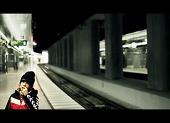 Railway Boy (TheFella) Tags: boy male slr hat station digital train canon concrete person eos photo europe alone child sweden pillar platform young tracks evil photograph trainstation processing rails lone nordic curious dslr scandinavia beanie cinematic malm malmo treatment supports postprocessing woolyhat 500d