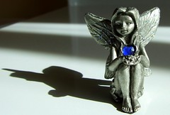 Sapphire and shadows (magnum_lady) Tags: blue glitter angel wings shadows magic charm fairy ornament lucky day70 sapphire goodluck assignment2 thebigone thisistoday mywinners abigfave superbmasterpiece diamondclassphotographer