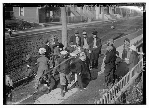 Thanksgiving Maskers scramble for pennies (LOC)