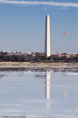 Coast Guard helicopter and Washington Monument (BACHarbin) Tags: winter orange usa cold reflection cars ice monument water buses stone clouds arlington season washingtondc frozen flying dc inflight districtofcolumbia memorial waiting personal aircraft president freezing frosty tourist va rivers obelisk nationalmall trucks helicopters obelisks washingtonmonument georgewashington contrails potomacriver memorials wintery dcskyline submittedtophotoshelter nationalmallandmemorialparks
