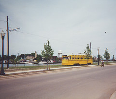 Westbound Kenosha Wisconsin yellow streetcar running alongside the harbor on 54th Street. Kenosha Wisconsin, Opening day. Saturday, June 17th 2000.