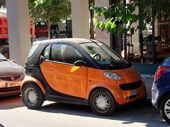 Orange and Black Smart Car