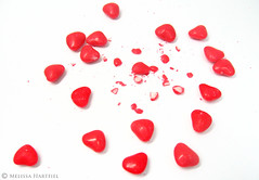 Broken Hearts Lie All Around (mhchipmunk) Tags: red white catchycolors hearts candy cinnamon candyhearts onwhite brokenhearts whiteground cinnamonhearts foodbeverage sweetcandy cmwd