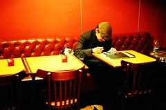 la lettre (gguillaumee) Tags: light people man paris france color film strange hat bar table chair nikon mood alone who taken cap sit mysterious bent moment capture anonymous nikonf80