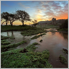 The Castle in the Morning (opobs) Tags: morning trees winter sky mist castle ice wet water pool grass southwales clouds sunrise reflections river puddle dawn frost mud fields 2008 1000 bridgend cadw wetknees ogmorecastle riverewenny
