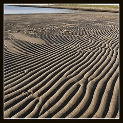 wrinkles (qletsqop) Tags: sea love beach strand coast sand bravo waves photographer zeeland pic zee excellent l awards wrinkles tides eb zand kust golven rimpels vloed stavenisse beachwaves superbmasterpiece ysplix qletsqop avision