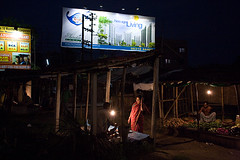 IMG_8430 New age living (Swiatoslaw Wojtkowiak) Tags: poverty india night canon asia poor ad globalization 5d capitalism globalisation kolkata bengal indien calcutta slum advertisment inde inequality
