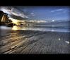 50... (Chee Seong) Tags: morning sky sun beach clouds sunrise canon sand wave malaysia flare soe hdr kuantan telukcempedak canon1022mm blueribbonwinner 400d diamondclassphotographer theperfectphotographer