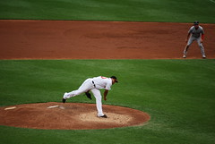 Here Comes the Pitch (Praying for Lions) Tags: boston ball james al baseball redsox baltimore os swing strike pitch fatherandson pitcher orioles rivals camdenyards mlb 200mm daygame majorleaguebaseball takemeouttotheballgame 200mmlens aleast nikond40x orioleswin63 herecomesthepitch