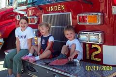 kids on firetruck