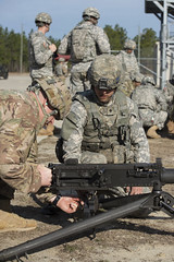 010917_B3_Sgt. 1st Class Harold Battenberg, of Headquarters and Headquarters Company, sets his M2 .50 weapon as Spc. Nicholas Kendall looks on for adherence to safety protocol. (FortBraggParaglide) Tags: sgt1stclassharoldbattenberg headquartersandheadquarterscompany spcnicholaskendall 27thengineerbattalion m250 range66 fortbragg theparaglide xviiiairbornecorps paratroopers airborne heroes specialoperationscommand family soldiers fayetteville northcarolina nc spouse unitedstates usa ironmike simmonsarmyairfield pope popearmyairfield campmackall 82ndairbornedivision specialforces johnfkennedyspecialwarfarecenter 82ndcombataviationbrigade toseemorephotosvisitwwwparaglideonlinenet