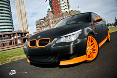 "M5 ""Supersport"" (BjornNieborg) Tags: netherlands beauty canon is rotterdam driving boulevard automotive location bmw 1855 m5 supersport orangeblack 55250 eos1000d supercardrive"