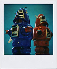 Two of a Kind (tubes.) Tags: blue red vintage polaroid twins metallic pair robots similar windup robby grabbyhands planetrobot actionplanet mainstreettoys