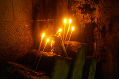 Offertory Candles - Holy Sepulcher (battyward) Tags: light shadow church fire israel ancient worship candles jerusalem religion altar holy flame fuego feuer oldcity feu offertory holysepulcher wowbeauty