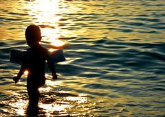 walkin' on sunshine (bNat!) Tags: sunset sea summer sun sol beach silhouette island mar child playa ibiza verano silueta eivissa littleboy niño isla cala nen platja baleares illa estiu balears manguitos calaconta supershot duetos wowiekazowie a3b flickrstas