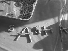 My name is tasty. (sashagberg) Tags: bw white black word table grey words sticks pretzels tray sasha