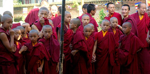 Nervous and getting ready for a major empowerment: little Tibetan monks holding hands and newly shaven, Tharlam Monastery, Boudha, Kathmandu, Nepal by Wonderlane