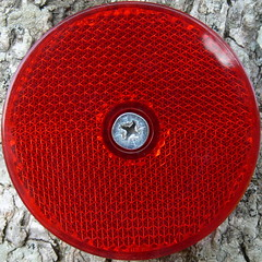 reflector (Foot Slogger) Tags: red geometric pattern almostsquaredcircle