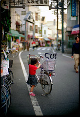 summer of '05 in Yanaka (TommyOshima) Tags: street leica red girl bicycle tokyo downtown kodak noctilux yanaka ultracolor
