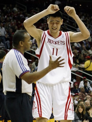 Yao Ming pleads his case to referee Eddie Rush during the Rockets-Warriors game in Houston on New Year's Eve.  Yao had some very questionable calls that got him into foul trouble and limiting his minutes.  Without him playing a full game, the Rockets made a game of it, but they couldn't hold on to a third quarter 11-point lead and lost 112-95.