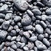Rocks by the black sand beach by Tom Coates
