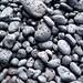 Rocks by the black sand beach by Tom Coates