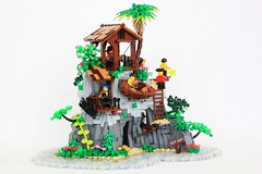 Captain Hookey Hand's Pirate Paradise (jsnyder002) Tags: lego pirate moc creation model build beach sand trees palmtrees jungle vegetation island water design cave opening winch boat roof path