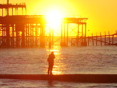 Photographing the ultimate Brighton sunset (brightondj - getting the most from a cheap compact) Tags: uk sunset sea sun sunlight beach silhouette sussex pier brighton photographer westpier pointandshoot groyne compact intothesun sonydscw210 nokidsintow 100camera