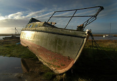 Old cruiser bathed in the morning sun at Heswall shore (jimmedia) Tags: old morning travel sea sun beach water wales port liverpool docks river boats coast sand waves yacht bathed coastal shore creativecommons sail dee cruiser mersey wirral heswall rivermersey wwwcoastandboatscouk