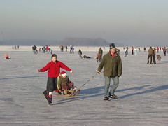 Back to Medieval times (rogiro) Tags: lake snow ice hockey senior freeassociation girl dark long candid skating skirt medieval skate middle sled brueghel elburg ages wintersports bruegel veluwemeer averkamp