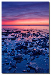 Birnbeck sunset (Roger.C) Tags: pink blue light sunset red sea sky orange sun water beauty canon evening coast seaside sand rocks 1855mm grad weston 30d anawesomeshot colorphotoaward platinumheartaward betterthangood colourvisions