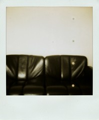 sofa (So gesehen.) Tags: black home polaroid switzerland blurry zurich sunday lofi outoffocus sofa spots scanned polaroidlandcamera friesenberg polaroid600film polaroid2000 sx70moddedfor600