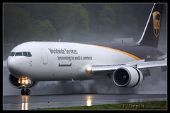 Reverse thrust (F/Depth Photography) Tags: field rain washington united ups service boeing parcel reverse thrust kbfi n324up 76734afer 27750724